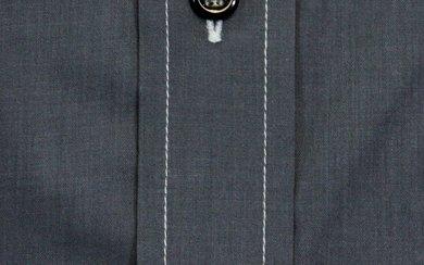 Doppelknopfmanschette, Brusttasche und Knopfleiste